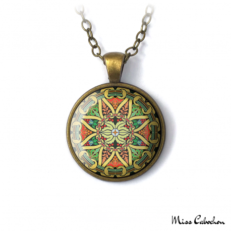 Necklace and pendant with geometric and floral motifs in shades of yellow, green and red